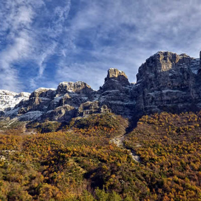 Autumn in Zagori, snow covers part of Astraka Towers above Papigo villages