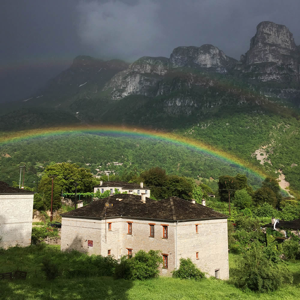 Double rainbow over Astra Inn in Papigo, Zagori